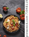 Traditional Italian pasta with tomato sauce 73948119