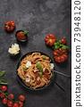Traditional Italian pasta with tomato sauce 73948120