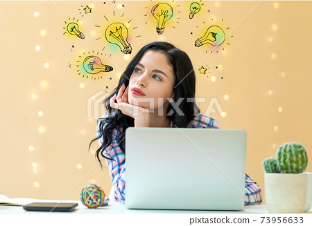 Idea light bulbs with young woman 73956633
