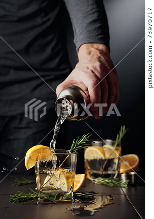 Cocktail Gin and Tonic with lemon and rosemary. 73970717