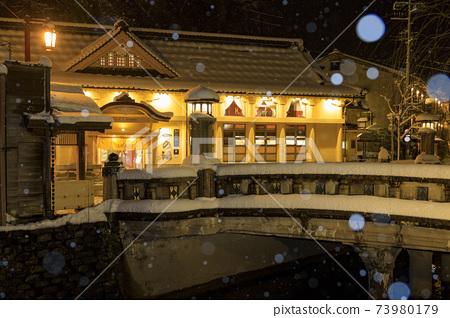 Kinosaki Onsen night view snow scene 73980179
