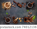 Coffee background with various of roasted coffee beans and flavourful ingredients for make tasty coffee setup on dark stone background. 74012136