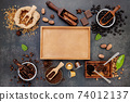 Coffee background with various of roasted coffee beans and flavourful ingredients for make tasty coffee setup on dark stone background. 74012137