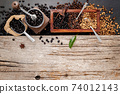 Various of roasted coffee beans in wooden box with manual coffee grinder setup on shabby wooden background. 74012143