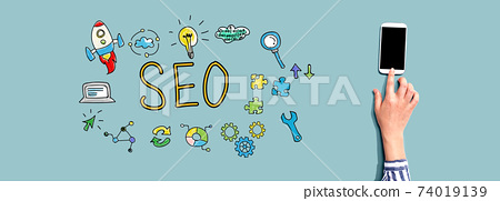 SEO with person using smartphone 74019139