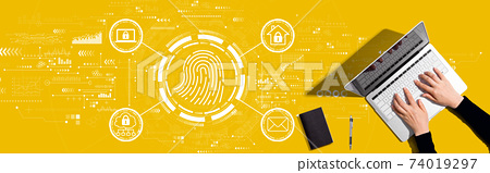 Fingerprint scanning theme with person working with laptop 74019297