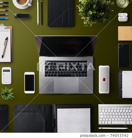 Flat lay top view office desk working space with laptop and office supplies on dark background. 74053542