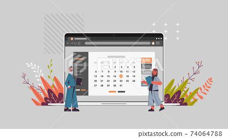 businesspeople planning schedule on laptop screen calendar planner organization management remind concept 74064788