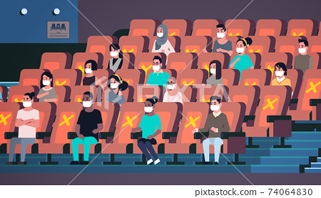people in protective masks watching movie keeping distance to prevent coronavirus social distancing concept 74064830