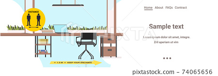 workplace desk with signs for social distancing yellow stickers coronavirus epidemic protection measures 74065656