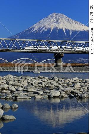 Shinkansen crossing the Fuji River and Mt. Fuji 74079509