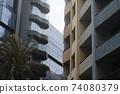 Concrete Facade With Balconies Contrasting With A Glass Facade Building 74080379