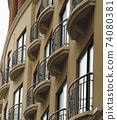 Building Facade With Tall Windows And Wrought Iron Railing Balconies 74080381