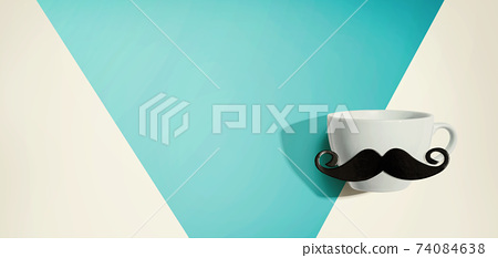 A cup of coffee with a paper mustache 74084638