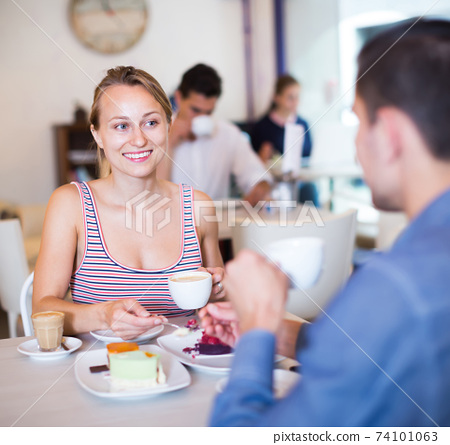 Ordinary smiling couple spending time together 74101063
