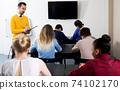 Teacher inspecting working process 74102170