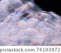Rainbow soap bubbles close-up. Abstract pattern 74103972