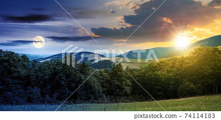 day and night time change concept above summer mountain landscape. beautiful scenery with sun and moon. beech forest and grassy alpine meadows on the hills. clouds on the gorgeous sky 74114183
