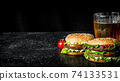 Burgers with beer and tomatoes. 74133531