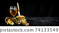 Burger with a knife,fries, beer in a glass. 74133549