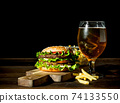 Burger with beer in a glass and fries. 74133550