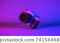 3D Rendering, Realistic mock up  tilted vintage camera in neon blue purple colors lighting and background. 74156468