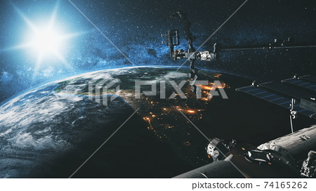 International Space Station Earth satellite with bright sun at cosmos over planet of Solar system 74165262