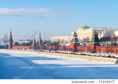 Kremlin embankment near frozen Moskva river 74169677