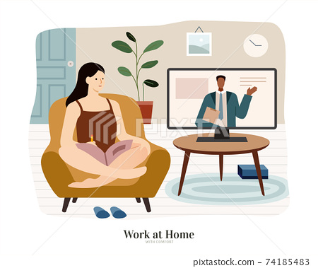 Woman sits on sofa and watches TV 74185483