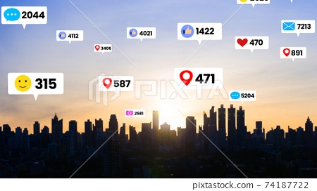 Social media icons fly over city downtown showing people engagement connection 74187722