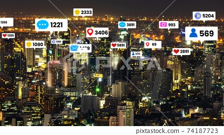 Social media icons fly over city downtown showing people engagement connection 74187723