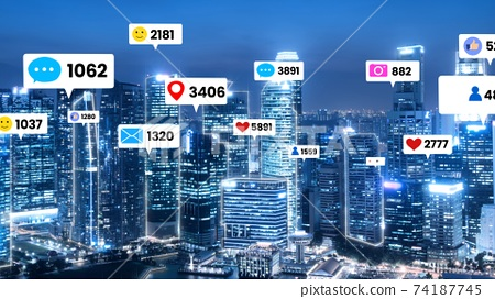 Social media icons fly over city downtown showing people engagement connection 74187745