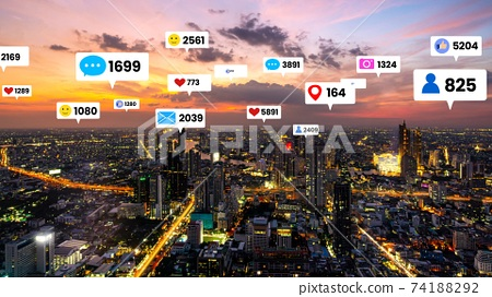 Social media icons fly over city downtown showing people engagement connection 74188292