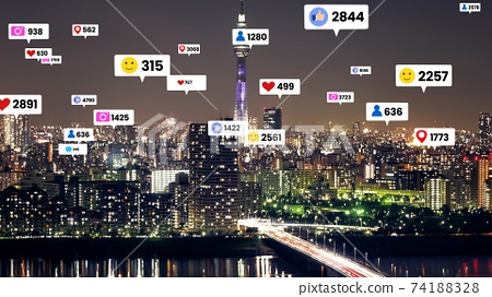 Social media icons fly over city downtown showing people engagement connection 74188328