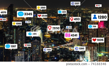 Social media icons fly over city downtown showing people engagement connection 74188346