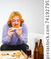 Man eating pizza. 74192795