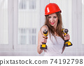woman using power driil for work at home 74192798