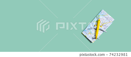 Travel theme with a miniature airplane and a map 74232981