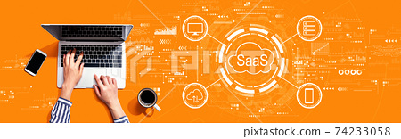 SaaS - software as a service concept with person using laptop 74233058
