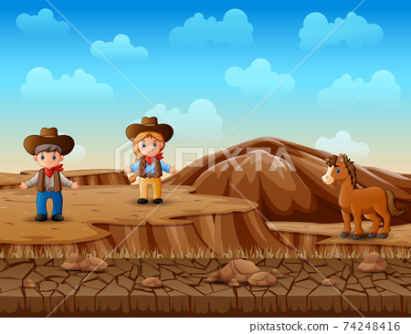 Cowboy and cowgirl in the desert landscape 74248416