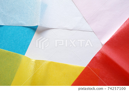 Colorful background of messy overlapping soft flower paper 74257100