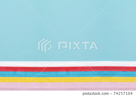 Colorful flower paper and a large copy space underneath the blue drawing paper 74257104