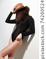 Beautiful young woman in hat. fashion brunette girl 74260524