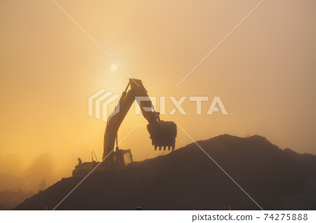 Construction Site in Dusty AIr 74275888