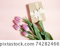 bouquet of tulips on pastel background 74282466