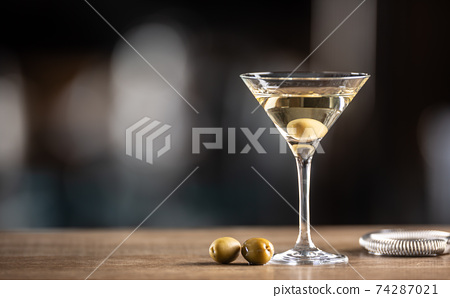 Dry Martini short drink cocktail with gin, dry vermouth and an olive garnish 74287021