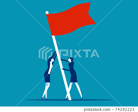 Flag as a symbol of success and heights. People raise a flag together 74292223