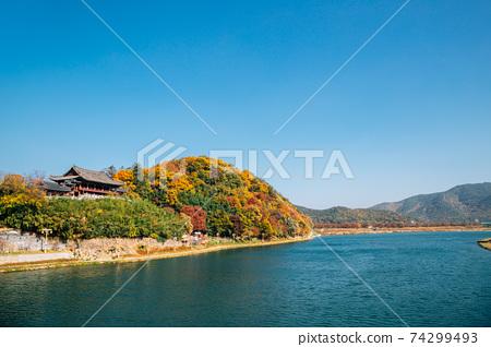 Yeongnamnu Korean traditional pavilion and autumn colorful mountain in Miryang, Korea 74299493