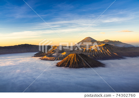 Bromo volcano mountain at sunrise in East Java, Indonesia surrounded by morning fog. 74302760