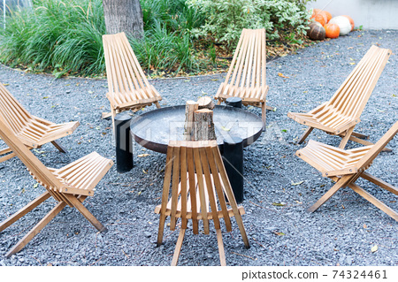 empty chairs around the fireplace 74324461